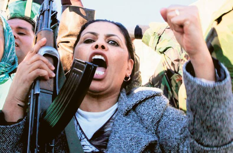 a-woman-during-a-rally-by-pro-gaddafi-supporters
