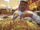 A salesman arranges gold jewellery at a shop in Riyadh