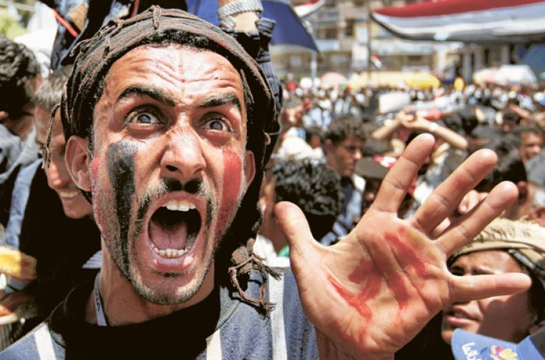 a-protester-chants-slogans-during-a-demonstration-in-yemen