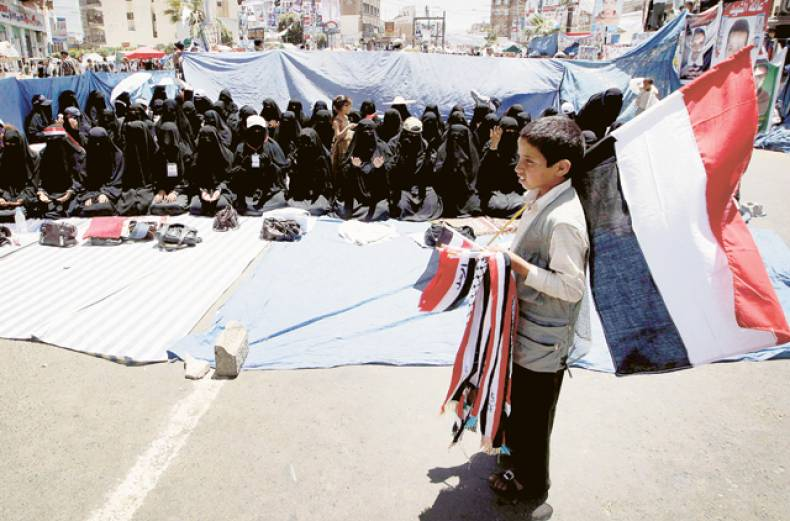 a-boy-sells-flags-during-a-rally