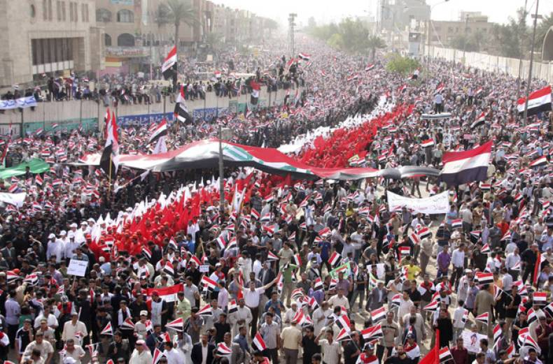 supporters-of-shiite-cleric-moqtada-al-sadr-wave-iraqi-national-flags-as-they-march-on-a-street