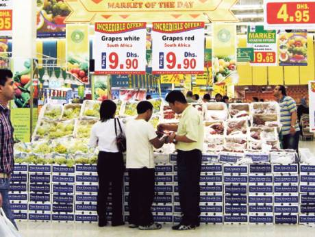 A shopper checks out the prices of goods at Lulu Hypermarket