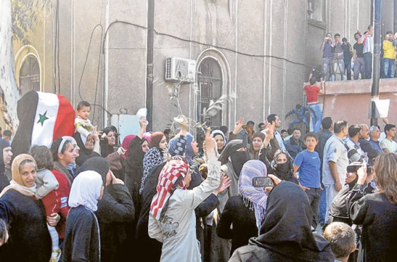 women-attend-a-protest-in-the-syrian-city
