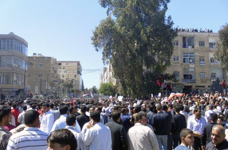 people-attend-an-anti-government-protest-in-daraa-syria