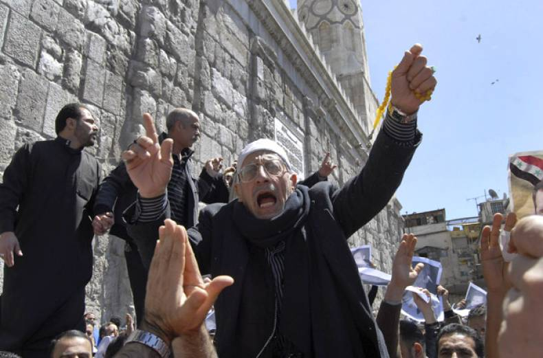 a-syrian-pro-government-protester-shouts-slogans-during-a-protest-outside-the-omayyad-mosque