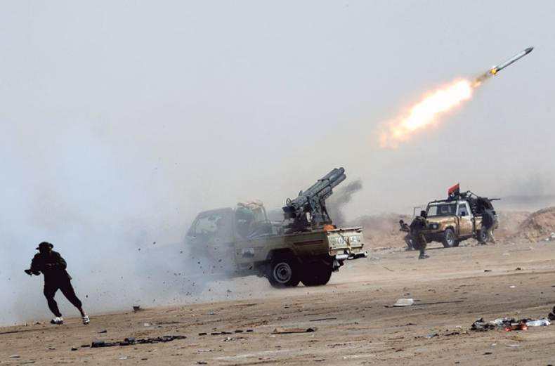 a-rebel-fighter-launches-missiles-against-gaddafi-s-army-in-ajdabiya