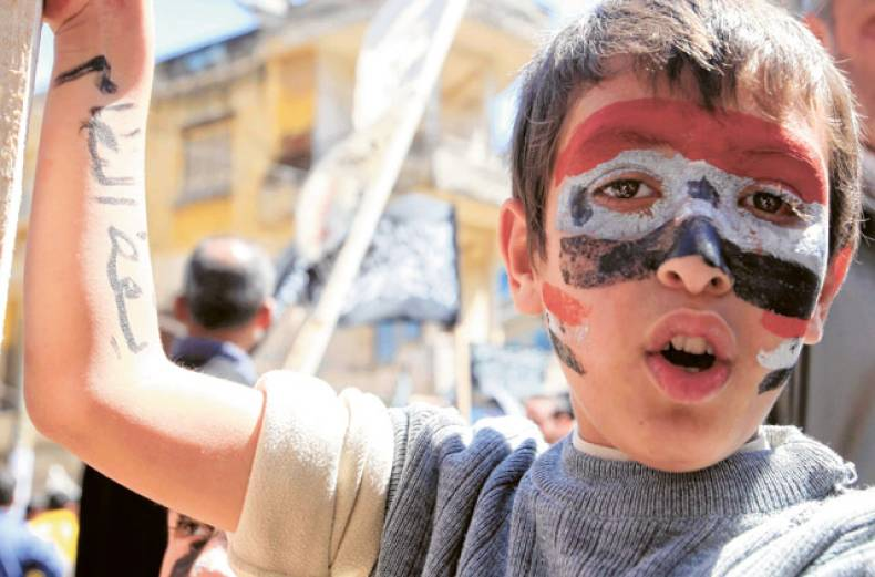 a-child-with-syrian-flags-painted-on-his-face