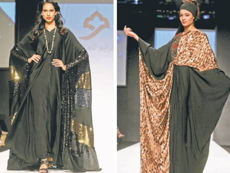 Models display the abaya collections from Marayem Abayas (left) and the Modest (right)