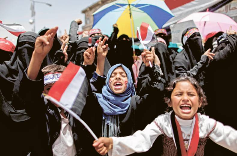 young-girls-shout-slogans-along-with-other-anti-government-protesters-during-a-demonstration