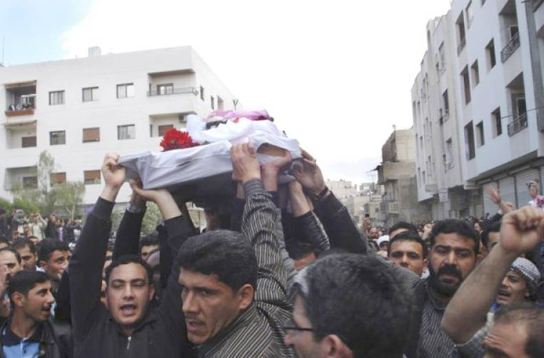 syrian-anti-government-protesters-carry-the-coffin-of-an-activist-who-was-killed-on-friday