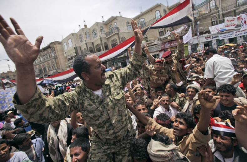yemeni-army-officers-lifted-by-anti-government-protestors-shout-slogans-during-a-demonstration