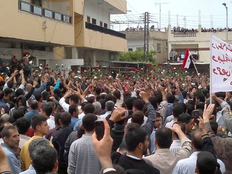 Protesters gather during a demonstration in the southern town of Nawa, near Daraa