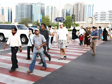 Pedestrian cross on a busy Corniche road in Abu Dhabi