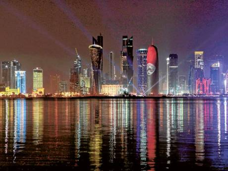 Doha's skyline is seen at night.