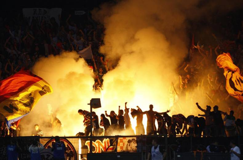 dinamo-bucharest-s-fans-cheer-for-their-team-during-romanian-cup-final-soccer-match