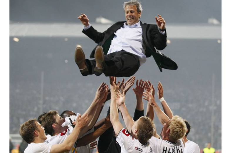 borussia-moenchengladbach-s-coach-lucien-favre-of-switzerland-is-thrown-in-the-air