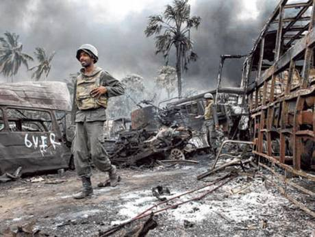 Sri Lankan troops walking amongst debris inside the war zone