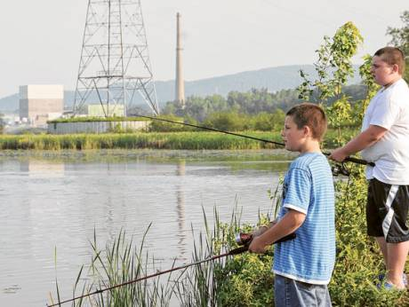 Two boys fish near a nuclear power station in Vermont, New Hampshire