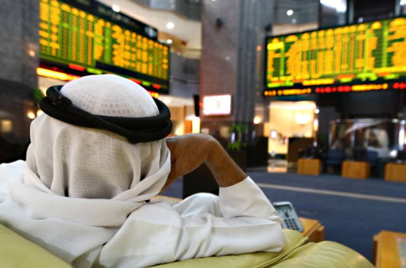 a-uae-investor-monitors-stocks-at-the-abu-dhabi-s-security-market