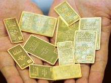 Gold at two-week low as rate hike seen