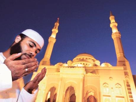 A man praying outside Al Noor Mosque