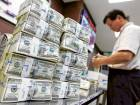 US dollar banknotes are stacked at the Korea Exchange Bank headquarters in Seoul