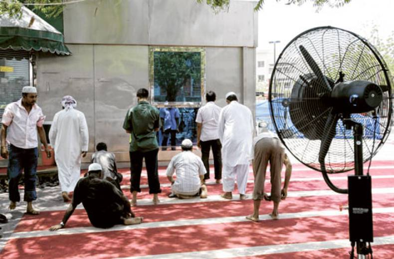 muslims-at-prayers-in-a-mosque-in-satwa
