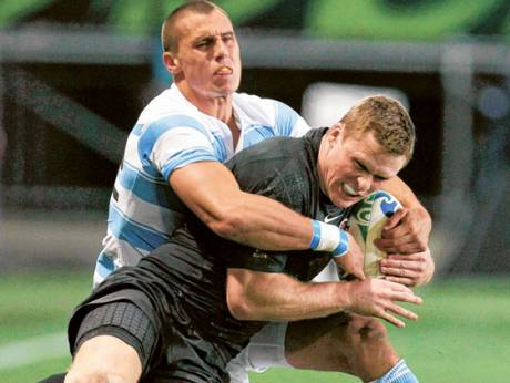 England's Chris Ashton is tackled by Argentina's Juan Jose Imhoff