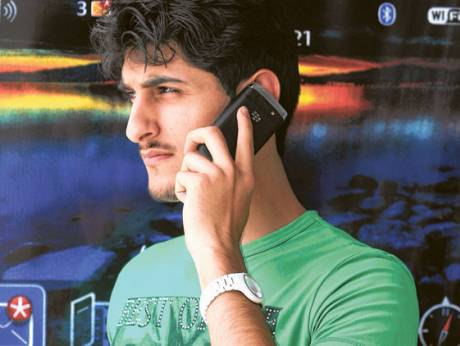 A man talks in mobile phone