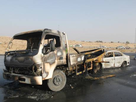 Charred vehicles from an accident in Dubai