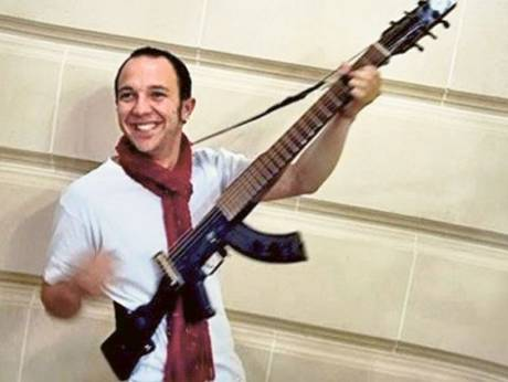 Cesar Lopez's instrument is one of the 17 gun-guitars in the world commissioned by the UN