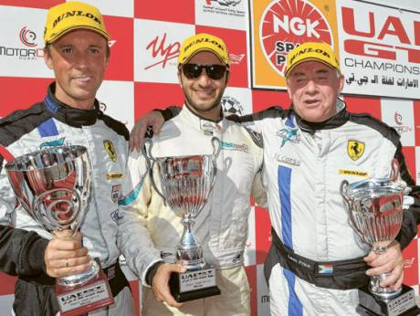 NGK UAE GT Class GTA winners Rob Barff and Leon Price with Class GTC winner Saeed Al Mehairi