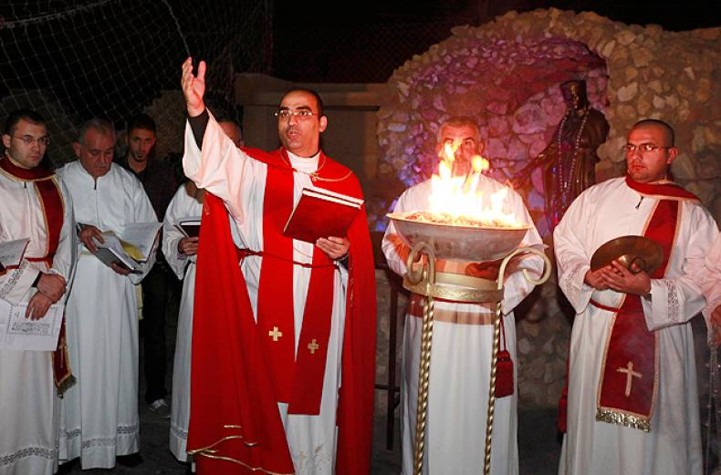 a-priest-leads-christmas-eve-mass-in-baghdad
