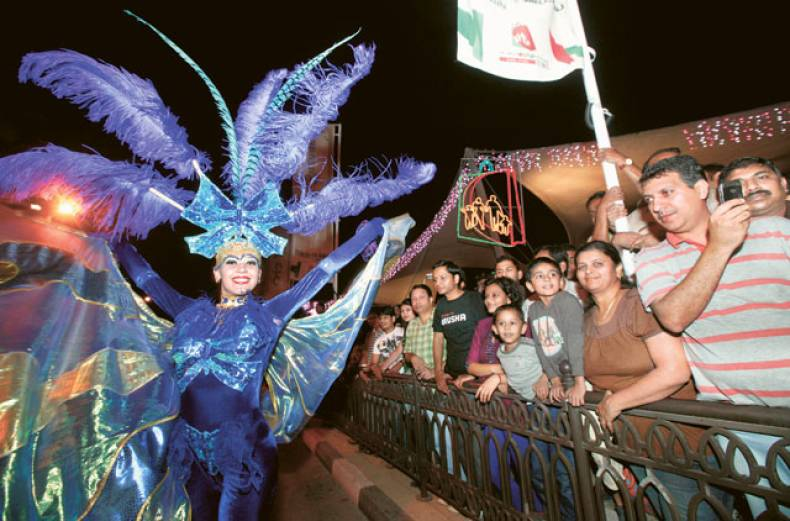 the-dsf-carnival-parade-entertains-residents-and-visitors-on-al-seef-street-in-bur-dubai