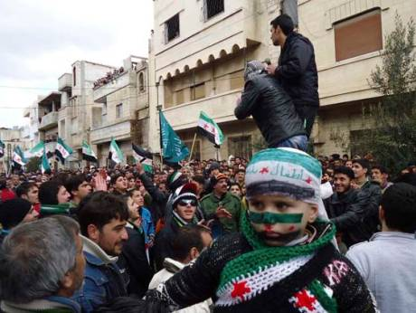Demonstrators take part in a protest in Syria