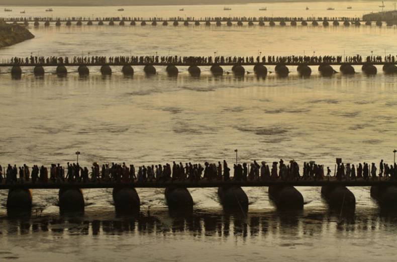 hindu-devotees-cross-a-newly-constructed-temporary-bridge-at-sangam