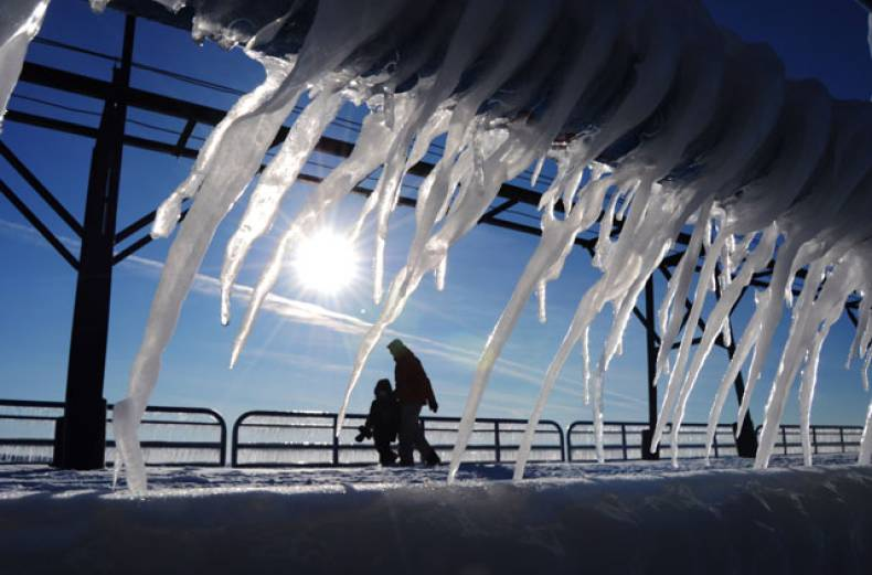 layers-of-ice-and-icicles-slowly-melt-along-the-north-pier-in-st-joseph-mich