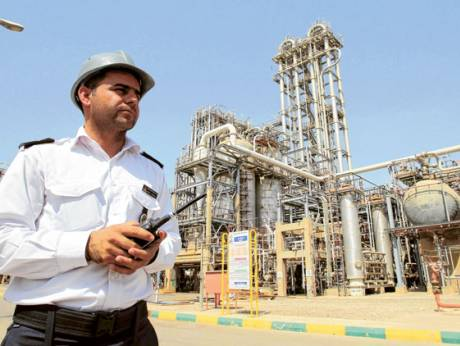 A security guard surveys the Mahshahr petrochemical complex in Khuzestan
