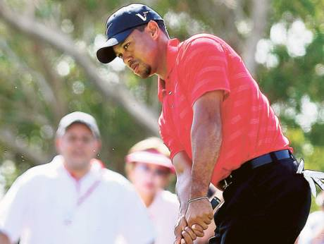 Tiger Woods plays a shot during the Abu Dhabi HSBC Golf Championship