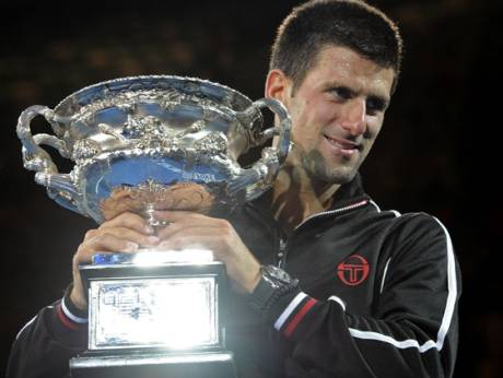 Novak Djokovic of Serbia holds  the trophy during the awarding ceremony