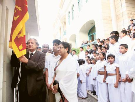 Sarath Wijesinghe hoists the Sri Lankan national flag at the embassy premises in Abu Dhabi