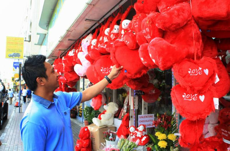 a-customer-is-checking-out-valentine-s-day-gifts-displayed-at-a-shop-in-dubai