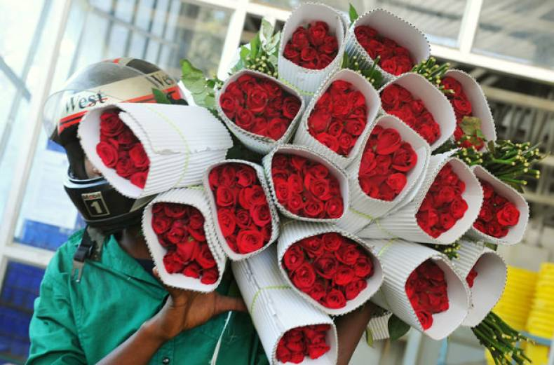 a-buyer-carries-roses-on-the-eve-of-valentine-s-day-in-bangalore