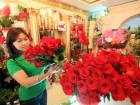 A salesgirl stocks roses  at her shop in Jumeirah, Dubai