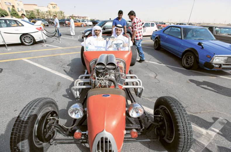 mohammad-al-mazroui-left-and-abdullah-hamadi-show-off-a-1930s-ford-hot-rod