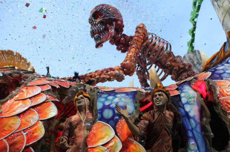 dancers-perform-on-a-float-during-the-parade-of-mancha-verde-samba-school-in-sao-paulo