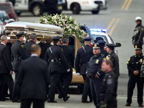 Pall-bearers carry the casket of Whitney Houston