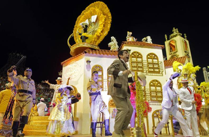 dancers-from-the-mocidade-alegre-samba-school-perform-on-a-float-during-a-carnival-parade