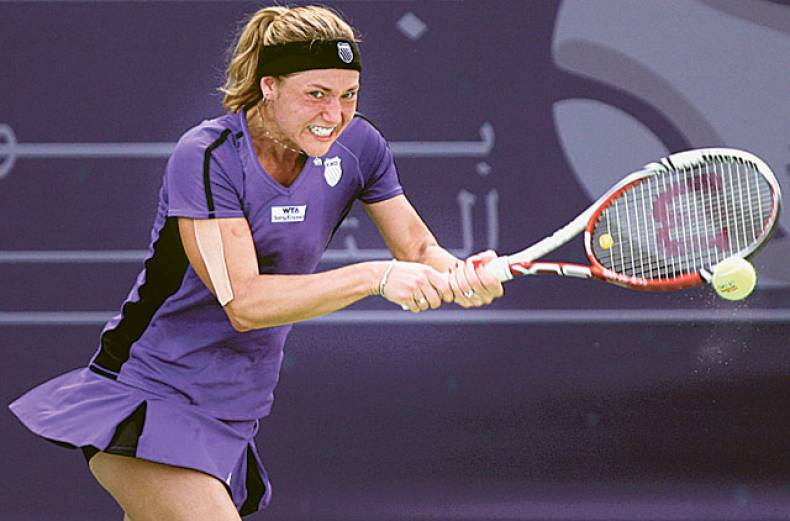 kateryna-bondarenko-hits-a-double-fisted-backhand-return-to-aleksandra-woznia