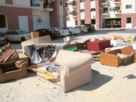 Discarded furniture in the Muhaisnah 4 area